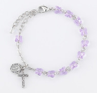 Lavender ~ 6mm Swarovski crystal butterfly beads in various colors Rhodium plated brass wire and chain. Silver oxidized Miraculous Medal and crucifix. Deluxe velvet box. Made in the USA.