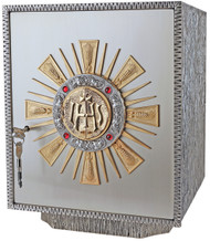 Exposition Tabernacle Style 657 is an Oxidized silver with gold rays. 24k bright gold plated inside. Four ruby stones. Dimensions: 15-1⁄4˝H. x 12˝W. x 12-1⁄4˝D. Door opening: 12-1⁄2˝H. x 10-3⁄4˝W. Wt. 57 lbs. Silver plated as shown.