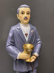 """Beautifully designed statue of the Venerable Matt Talbot. Considered to be the Patron Saint of Alcoholism. His Feast Day is June 16. This Matt Talbot statue was designed by our artisans at the St Jude Shop. Matt Talbot statue is made of a resin material and stands almost 12"""" in height. This exquisite statue represents all areas of addiction-whatever it may be; Alcohol, drugs, cigarettes, gambling are all represented on this statue  Read his story below:   Matt Talbot was one of twelve children born to a poor family in Dublin. His addiction to alcohol began at twelve, when he got his first job with a wine merchant. Before long, drink had become the primary focus of his life. All the wages he earned carrying bricks went to support his addiction. What funds he lacked, he begged, borrowed, or stole.   This lasted until the age of twenty-eight, when he was overcome with disgust for his life. Entering a church, he made his confession and took the pledge of abstinence for three months. His mother had cautioned him: """"Go, in God's name, but don't take it unless you are going to keep it."""" Those first three months were agonizing. At one point he collapsed on the steps of a church, in despair at the thought of breaking his oath.   But he kept at it, renewed it for another three months, and thus, by constant vigilance, remained sober for the next forty-one years. From the point that he took the pledge, the focus of his life shifted dramatically. He became a Franciscan tertiary, attended daily Mass, ate sparingly, prayed half the night, and gave generously to charity. (He never carried money with him—always fearful of the temptation to step into a pub.)   On June 7, 1925, Talbot collapsed in the street and died. It was discovered that his body was wrapped in penitential chains, which were buried with him. His cause for canonization was soon opened, and in 1975 he was declared venerable. He is the patron of alcoholics."""