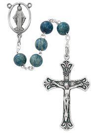 7 millimeter Light Blue Wooden Beads Rosary with silver oxidized Crucifix and Center. Rosary presents in a deluxe gift box.  Made in the USA.