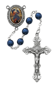 7mm Blue Pearl Glass Beads Rosary with rhodium plated pewter Crucifix and OL of Knots Center. Rosary presents in a deluxe gift box.  Made in the USA.
