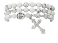 6mm simulated Howlite beads make up this full stretch rosary bracelet. The bracelet when off the wrist is a full rosary to pray on.