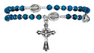 4mm blue crystal arum beads with silver seed beads make up this full rosary bracelet. The bracelet when off the wrist is a full rosary to pray on. Comes carded. Made in the USA