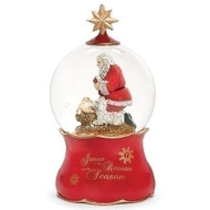 """Wind up Kneeling Santa Dome. Message on the bottom says """"Jesus is the Reason for the Season"""".  Dimensions: 7""""H x 4""""H x 4""""L.  Made of Glass, Water, and Metal."""