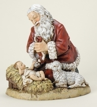 "Kneeling Santa with Lamb Figure. Resin/Stone Mix.  Dimensions: 8""H x 8.75""W x 6.75""D"