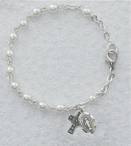 "Youth Size 3 Millimeter Glass Pearl Bracelet.  Bracelet measures 6 1/2"" in Length.  Bracelet has a Pewter Celtic Cross and Miaculous Medal Charm."