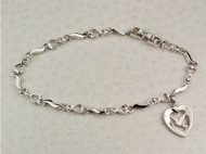 "7 1/2"" Cubic Zirconia Bracelet with Rhodium Plated Holy Spirit inside a heart Charm. Deluxe Gift Box Included"