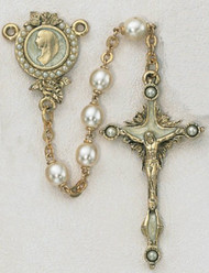7 Millimeter Pearls of Mary Rosary. Gold Plated Pewter Crucifix has 4 pearls on cross and center has the head of Mary encircled in same white pearl beads. Deluxe Gift Box Included