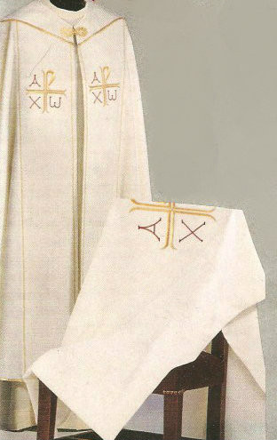 """Cope is 56"""" In Length. Assisi Fabric. 90% Polyester, 10% Gold Thread. Matching Chasuble, Overlay Stole, Humeral Veil, Dalmatic and Deacon Stole are available. Colors: White, Red, Green, Purple and Rose. These items are imported from Europe. Please supply your Institution's Federal ID # as to avoid an import tax. Please allow 3-4 weeks for delivery if item is not in stock"""