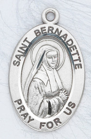 "Sterling silver St Bernadette 7/8"" oval medal. St Bernadette medal comes on a 18"" Genuine rhodium plated fine curb chain. Medal comes in a deluxe velour gift box. Engraving option available. Made in the USA"