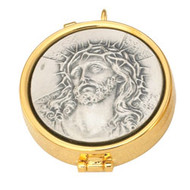 "The Head of Christ Pyx. 7 host capacity. Measures 2 1/8"" x 5/8"". High polish inside. Based on 1 3/8"" host"