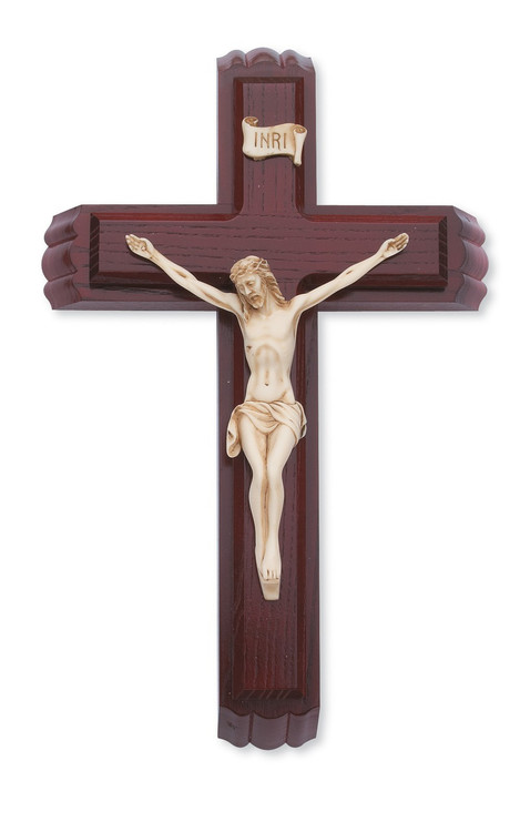 """This 12"""" cherry stained crucifix with Italian corpus forms the lid for a box with a small vial for holy water and two candles nestled inside. Packaged in a deluxe gift box."""