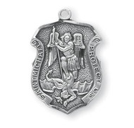 "St. Michael Sterling Silver Policeman's Badge Medal. Dimensions: 0.9"" x 0.6"" (22mm x 14mm) St Michael Policeman's Badge Medal comes on a 20"" Genuine rhodium plated curb chain with a genuine rhodium-plated chain. Presents in a deluxe velour gift box."