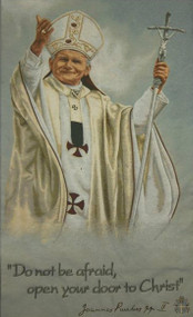 Image of a highly-detailed woven rendering of Pope John Paul II on a hanging banner.