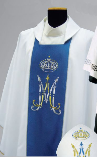 Marian Chasuble in Primavera Fabric (100% polyester) with embroidered blue panel in front and back. Features Marian Symbol. Includes inside stole. These items are imported from Europe. Please supply your Institution's Federal ID # to avoid an import tax. Please allow 3-4 weeks for delivery if item is not in stock