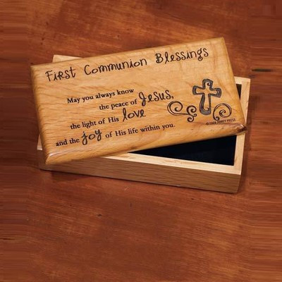 """Solid wood box is lined with soft fabric and has a laser engraved lid. First Communion Blessing:  """"May you always know the peace of Jesus, the light of His love, and the joy of His life within you."""" 7"""" x 3.5"""" x 2.25""""."""