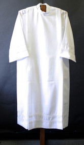 Alb in 100% smooth poplin polyester for easy care. One inch woven lace bands on cuffs and on the bottom of the garment. Your choice of velcro or button closure. Ample Cut sizes available upon request, please contact us at 800-523-7604 for details. (See sizing charts below product descriotion)