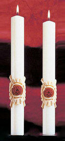 Holy Trinity Side Altar Candles. Enhance the Presence of the Paschal Candle-a perfect decorative touch!. 51% Beeswax ~ Made in the USA Add beauty to your sanctuary with the Holy Trinity Side Altar Candles. • These altar candles perfectly complement the Holy Trinity Paschal candle. • Candles are available in sets of two. • Colored bands around the base of the candles add a vibrant blueish-purple and shining silver to your sanctuary. • Candles are made with 51% beeswax for a clean burn. • Choose from four different sizes. • Candles are made in the US. Purchase these and other church supplies you need from St. Jude Shop.