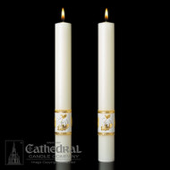 Ornamented Side Altar Candles.   Enhance the presence of your Paschal Candle with a pair of beautiful complementing 51% Beeswax Altar Candles. Handcrafted by Artisans. Made in USA.  Add beauty to your sanctuary with the Ornamented Side Altar Candles.  • These altar candles perfectly complement the Sacred Heart Paschal candle. • Candles are available in sets of two. • Colored bands around the base of the candles add a vibrant blueish-purple and shining silver to your sanctuary. • Candles are made with 51% beeswax for a clean burn. • Choose from four different sizes. • Candles are made in the US. Purchase these and other church supplies you need from St. Jude Shop
