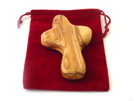 "In times of stress, turmoil and uncertainty, it's comforting to have something to hold onto. The Cross is hand-carved in Bethlehem by Christian Artisans. The Olive wood will develop its own patina with time and usage. It is a perfect gift for Him or Her and it makes a perfect companion for prayers or strength. It comes in a velvet pouch with a Certificate of Origin.  Small Cross ~ 2""-3"" high. Large Cross ~ 4"" high"