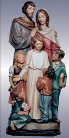Sculpture of holy family embracing one another.