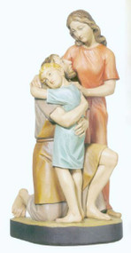Sculpture of Saint Joseph kneeling with Child Jesus embracing him, and Virgin Mary standing beside them.