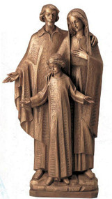 Bronze sculpture of Saint Joseph and Virgin Mary looking down on Child Jesus. Mary standing beside them.