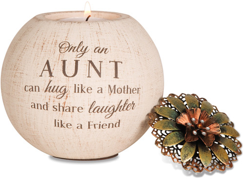 "5"" Round Tea Light Candle Holder. Tea light Candle Holder is  packaged securely in a printed box. The candle holder is made from terracotta and features a decorative metal lid and fits a regular tealight (included).""Only an Aunt can hug like a Mother and share laughter like a Friend"" is written on the front of the candle holder."