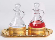 "Processional Cruet Set. Bright gold plated tray measures I5-1/2"" x 10"".  Cruets are 6""H. 10 ounce capacity"