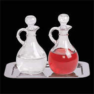 "Cruet & Tray Set. Polished Stainless Steel Tray measures 6 1/2"" x 9 1/2"". Cruets 6"" High, 10 oz. Capacity. Tray and Cruets can be purchased separately"