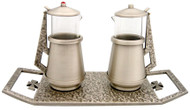 """Cruet & Tray Set.  Cast bronze antique silver plated tray measures 9 3/4"""" X 4 1/4"""". Cruets, 4 1/2"""" Height,4 oz. Capacity. Imitation ruby and diamond on hinged covers."""