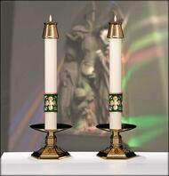 Two white Christus Rex altar candles with gold and green symbol at bottom of each candle.
