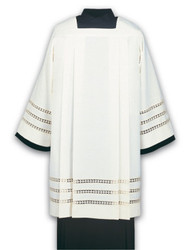 Washable Surplice Square neck with four pleats front and back.  Easy to launder, wash-and-wear fabric  Sleeves and skirt are decorated with three inserted woven borders; only in Greco-fabric, beige.  Normally ships within 18 working day(s), with the exception of hand-embroidered and custom orders. All sizes measured from top of shoulder to hem. These items are imported from Europe. Please supply your Institution's Federal ID # as to avoid an import tax.  Please allow 3-4 weeks for delivery if item is not in stock