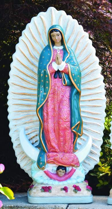 """This 29"""" cement statue of Our Lady of Guadalupe is a great addition to your garden. The Our Lady of Guadalupe statue comes in two finishes Natural Cement finish and a Detailed Stain finish.  Dimensions: Height: 32"""", Width: 17"""",  BW: 10.5"""", BL: 9"""", Weight: 90 lbs. Statue is handcrafted made to order so please allow 4-6 weeks for delivery. Made in the USA."""