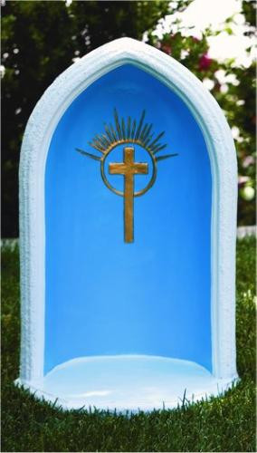 """This 24""""H cast stone pointed grotto features a gorgeous cross detailing at the center. This 24""""H pointed grotto is designed to display an 18""""H statue. You can find this in a natural cement color or with detailed stain that includes a blue background, white trim, and a gold cross. Details: Base width 15"""" Base length 13"""" 55lbs Allow 4-6 weeks for delivery Made in USA"""
