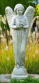 """This gorgeous and elegant cement angel garden statue is a great addition to your garden. This statue features an angel holding a dove and is made to order, please allow 4-6 weeks for delivery. Details: Dimensions: 29""""H x 11.5"""" W x 6.75""""BW x 7""""BL Weight: 40 lbs Made of cement Allow 4-6 weeks for delivery Made in USA"""