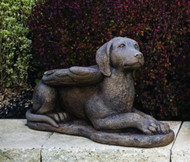 """This guardian angel dog statue can make a special addition to your garden. This statue features a dog laying down with wings. Details: Dimensions: 11.75""""H x 9.75""""W x 19.5""""L x 7""""BW 19.5 lbs Made to order. Allow 4-6 weeks for delivery.  Made in USA"""