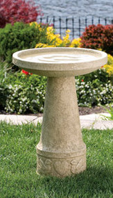 Bird bath made with cement and detailed along the base.