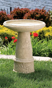 "This Tuscan sun bird bath is detailed with a branch of leaves at the base. This is a simple and beautiful bird bath that will make a great addition to your garden.  Details:  24""H Top diameter 18"" Base diameter 10"" 84 lbs Made to order Allow 4-6 weeks for delivery Made in USA"