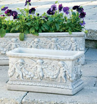 """Cement Angel Flower Box Planter. This box planter features small angels and beautiful detailing that will help your garden stand out. Plant your favorite flowers in this gorgeous angel planter box.  Details:  7.75""""H x 7""""W x 15""""L 20lbs Made to order. Allow 4-6 weeks for delivery Made in USA"""