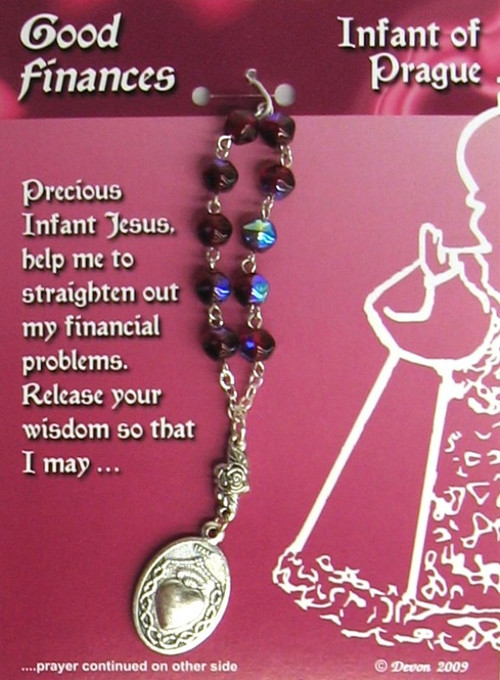 "This Infant of Prague One Decade Rosary is For Good Finances. Contains a prayer on the reverse side of the card.  Pray one decade of the Rosary, and then pray the prayer on the card.  4"" long; medal is 1"" x 5/8""."