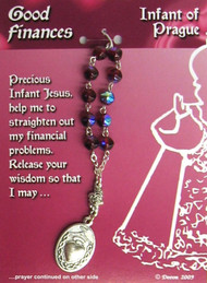 """This Infant of Prague One Decade Rosary is For Good Finances. Contains a prayer on the reverse side of the card.  Pray one decade of the Rosary, and then pray the prayer on the card.  4"""" long; medal is 1"""" x 5/8""""."""