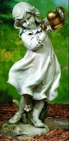 """This beautiful garden statue can make a great addition to your outdoor space. This statues features a little girl holding a gold watering can and standing by flowers. Details: Dimensions: 22""""H x 10.5""""W x 11""""D Resin and stone mix"""