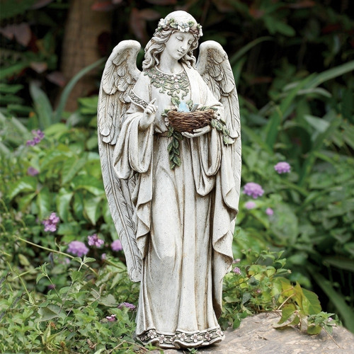 """If you are looking for a beautiful addition to your garden, this angel statue is a great option. This statue features an angel holding a nest. This is a beautiful and elegant garden statue. Details: Dimensions: 24""""H x 10.75""""W x 8""""D Resin and stone mix"""