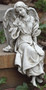 """Garden Collection ~ Sitting Angel - Facing Left. Dimensions:12.75""""H x  6.5""""W 5.75""""D. Stone / Resin Mix"""