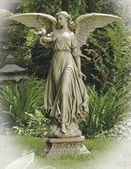 Walking angel garden statue on a pedestal.