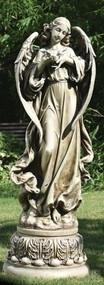 Garden statue of an angel on a pedestal, holding a dove.