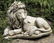 Statue of a lion and a lamb laying together.