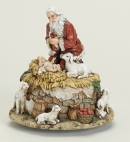 "Kneeling Santa w/ Jesus ~ Musical  ""O' Come All Ye Faithful"". 5.75""H x 5.5""W x 5.5""D. Resin/Stone Mix"