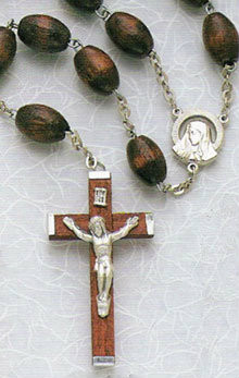 """Bring together the family in devotion and prayer with this Family Wood Rosary. The oval rosary beads are strung together by a series of lightweight chains and the wooden crucifix holds a miniature image of Christ. Together with the Catholic bible and pictures of saints, the rosary is a constant fixture to show Catholic devotion. Reflect on the life of Jesus and the Blessed Mother with the simple and stunning Family Wood Rosary. Wood family rosary 30"""" long in black or brown"""